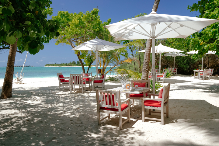 view on the beach and sea from the drift restaurant in kanuhura hotel maldives