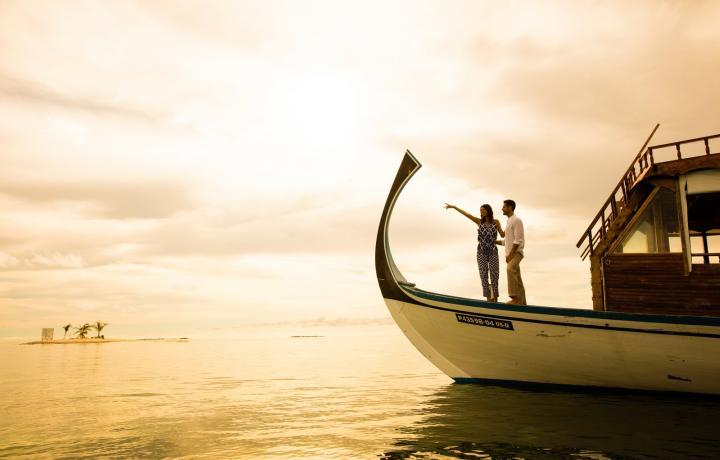 couple on a boat at sunset